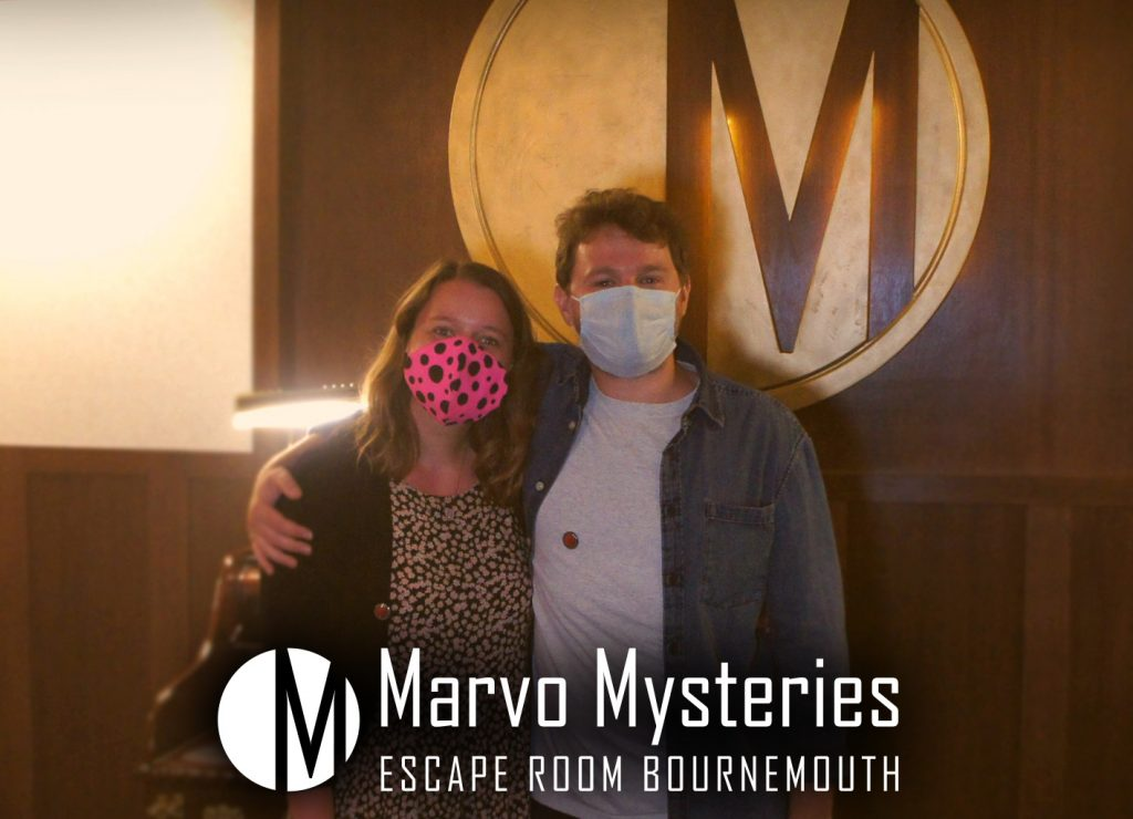 Dan posing for the camera with his partner, in the Marvo Mysteries Escape-room Bournemouth